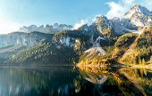 Majestic Alpine Highlands In Sunny Day. Unsurpassed Sunrise In The Mountains. Majestic Azure Lake Un poster