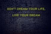 Positive Inspiring Quote On Neon Sign Against Brick Wall Dont Dream Your Life Live Your Dream. poster