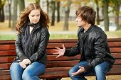 conflict in young people relationship. Anger man and sad girl outdoors