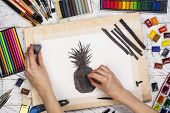 Artist Is Drawing Charcoal Pineapple Sketch. Workplace Of Artist Background. Top View Of Painter Too poster