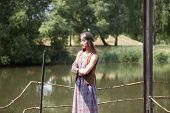 Young Hippie Woman Standing On Wooden Bridge In Park poster