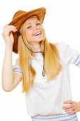 Happy blond girl wearing stetson hat and white chemise over isolated background