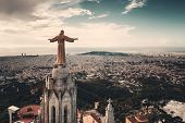 Jesus statue atop of Tibidabo Temple of the Sacred Heart of Jesus viewed from air in Barcelona, Spai poster
