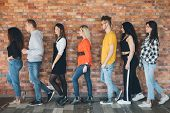 Orderly Queue. Millennials Moving Toward Future. Young Men Women Standing In Line Full Length. Antic poster