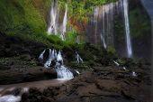 Beautiful Tumpak Sewu Waterfall, Tumpak Sewu Waterfall Or Also Called Coban Sewu Is A 120 Meter High poster