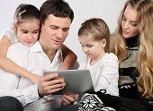 Happy Young Family Using A Tablet Computer