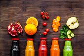 Bottles With Fresh Carrot, Tomato, Apple, Cucumber, Lemon, Pomegranate Juices On Wooden Background T poster
