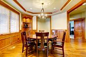 Dining Luxury Room With Wood Molding And Floor.