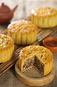 Chinese mid autumn festival foods. Traditional mooncakes on table setting with tea set.  The Chinese