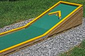 foto of miniature golf  - Small golf course built for children in a recreational space - JPG