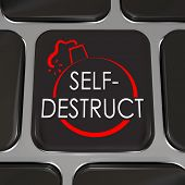 The words Self-Destruct and a bomb picture on a black computer keyboard key to illustrate giving up,