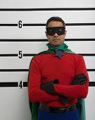 Superhero standing in police line up