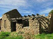 stock photo of purlin  - Decaying Historic farm building constructed of schist stone and wood - JPG