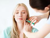 beauty, healthcare and medical concept - beautician with patient doing anti-aging injection in hospi