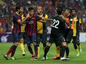 KUALA LUMPUR - AUGUST 10: Malaysia's players (yellow) and FC Barcelona players (maroon/blue) fights in the game at the Shah Alam Stadium on August 10, 2013 in Malaysia. FC Barcelona wins 3-1.