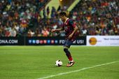 KUALA LUMPUR - AUGUST 10: FC Barcelona 's Neymar Jr. controls the ball in a friendly game against Malaysia at the Shah Alam Stadium on August 10, 2013 in Malaysia. FC Barcelona wins 3-1.