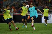 KUALA LUMPUR - AUGUST 9: FC Barcelona's Lionel Messi (blue bib) practices during training at the Buk
