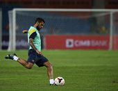 KUALA LUMPUR - AUGUST 9: FC Barcelona's Dani Alves practices during training at the Bukit Jalil Stad