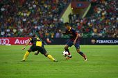 KUALA LUMPUR - AUGUST 10: FC Barcelona's Neymar Jr. (maroon/blue) leads in attack against the Malaysian team at the Shah Alam Stadium on August 10, 2013 in Malaysia. FC Barcelona wins 3-1.