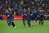 KUALA LUMPUR - AUGUST 10: FC Barcelona's players jog during warm-up before the match against Malaysia at the Shah Alam Stadium on Aug 10, 2013 in Malaysia. FC Barcelona wins 3-1.