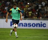 KUALA LUMPUR - AUGUST 9: FC Barcelona 's Gerard Pique practices during training at the Bukit Jalil S