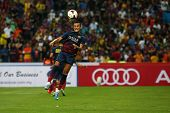 KUALA LUMPUR - AUGUST 10: FC Barcelona 's Alexis Sanchez heads the ball in game against Malaysia that was played at the Shah Alam Stadium on August 10, 2013 in Malaysia. FC Barcelona wins 3-1.
