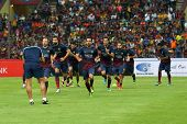 KUALA LUMPUR - AUGUST 10: FC Barcelona 's players jog during the warming up session in game played at the Shah Alam Stadium on August 10, 2013 in Malaysia. FC Barcelona is on an Asia Tour to Malaysia.