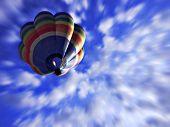 Rainbow coloured balloon gliding on a bright sunny day