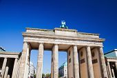 Brandenburg Gate. German Brandenburger Tor in Berlin, Germany. Sunny blue sky