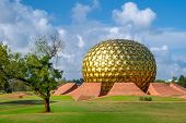 AUROVILLE, INDIA - MARCH 7: Matrimandir - Golden Temple on March 7, 2013 in Auroville, Tamil Nadu, I