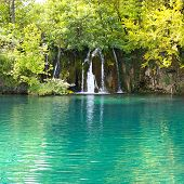 waterfall and turquoise lake
