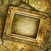 old golden empty frame hinging on wall