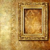 carved gilded frame over old wallpaper