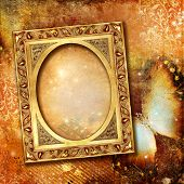 background with blank golden frame and butterfly