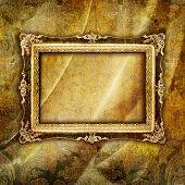 antique blank frame over golden brocade