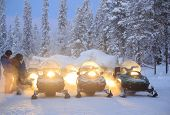 stock photo of recreational vehicles  - Snowmobile engine start on snow and ready to use in Kiruna Sweden - JPG