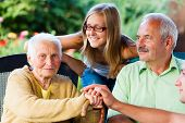 picture of granddaughters  - Elderly woman welcoming her family  - JPG