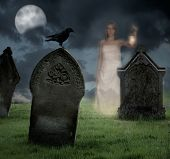 picture of moonlit  - Woman holding lantern haunts cemetery at Halloween - JPG