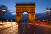 stock photo of arch  - Arc de Triomphe in Paris at sunset  - JPG