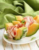 Italian antipasti melon with smoked ham (prosciutto melone)