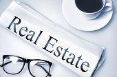 Real Estate word on newspaper