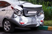 stock photo of speeding car  - A car has a big dent after an accident