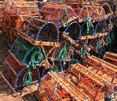 image of lobster trap  - A stacked pile of Lobster Traps on quayside - JPG
