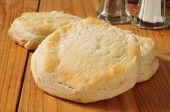 stock photo of buttermilk  - Fresh baked buttermilk biscuits on a rustic wooden surface - JPG