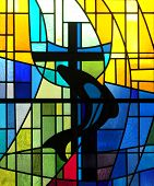 Modern stained glass window depicting dolphin and cross