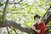 Teenage Boy Standing In Woods