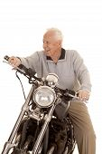 Elderly Man On Motorcycle Look Side