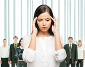Upset businesswoman has a head ache. She is tired of her work, office and colleagues.