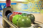 Bowling Ball Machine With Person Preparing To Bowl In The Background