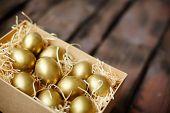 Golden Easter eggs in box
